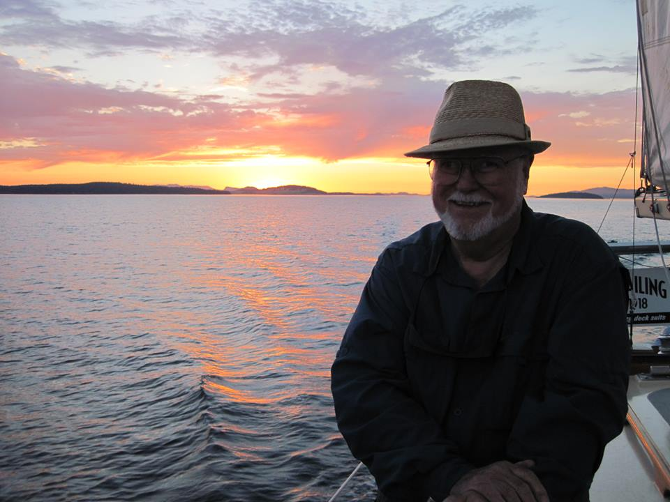 Rick Weis sailing at sunset