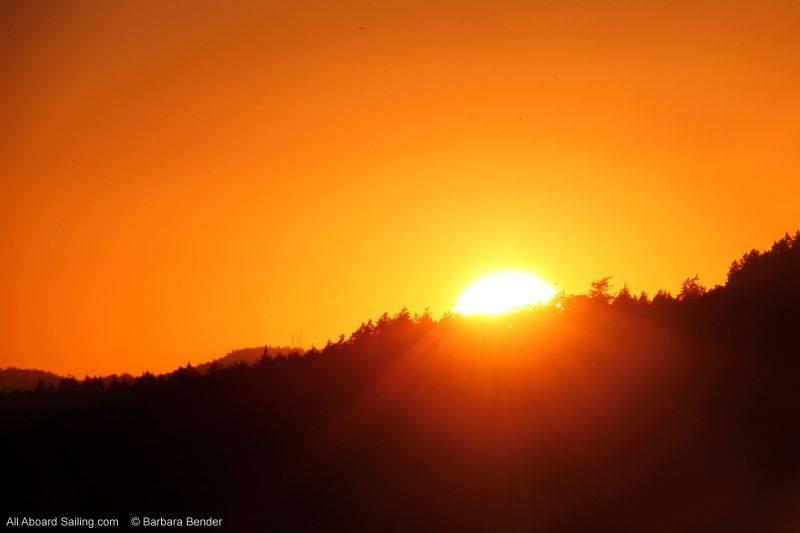 Sun setting behind Stuart Island