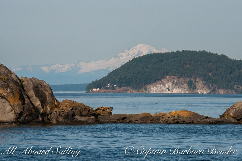 Looking towards Turn Point Lighthouse, Lovers Leap, and Mount Baker