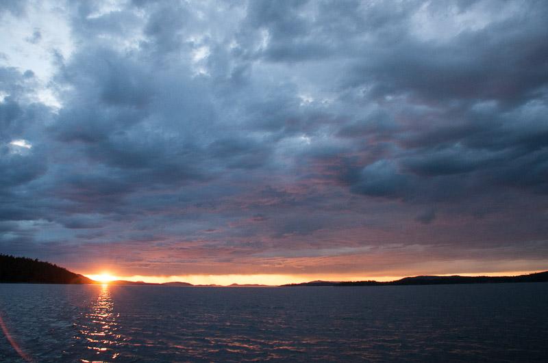 Sun shines below cloud layer