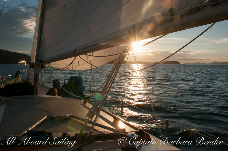 sailing into summer solstice sunset