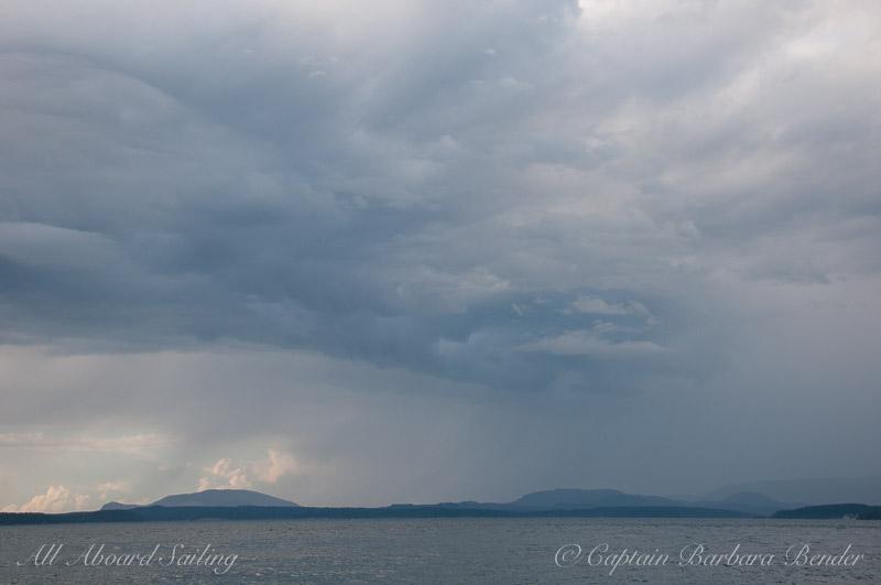Turtleback Mountain under dark rain clouds