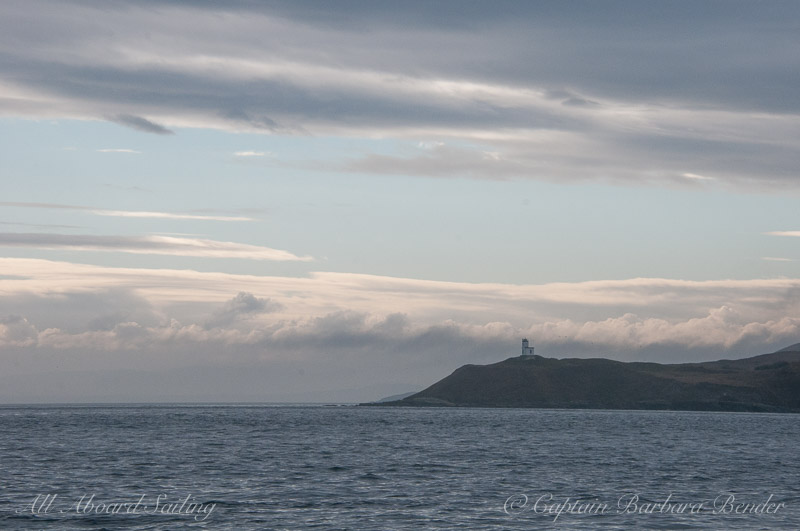 A break in the clouds over Cattle Point Lighthouse