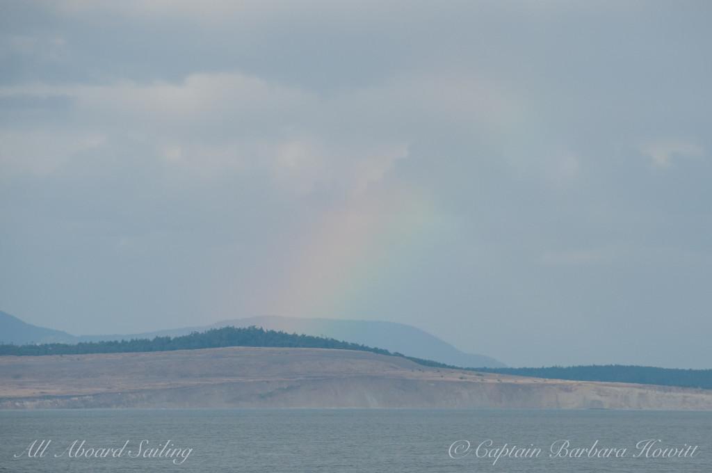 A rainbow appears over Lopez Island