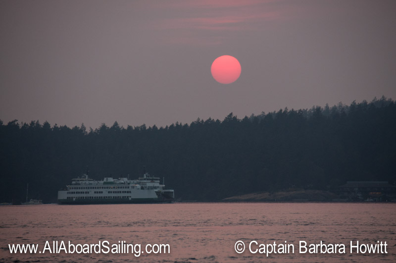 Washington State Ferry with pink sun