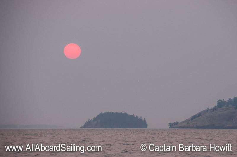 Pink sun over Sentinel Island