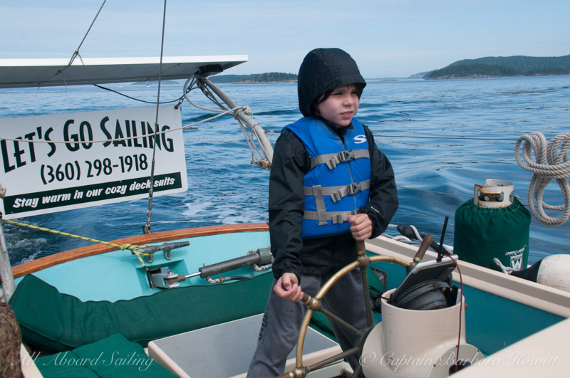 Taking the helm to sail to San Juan Island
