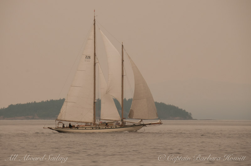 Wooden Sailboat Race from Deer Harbor, Orcas Island. Haze in air from forest fires