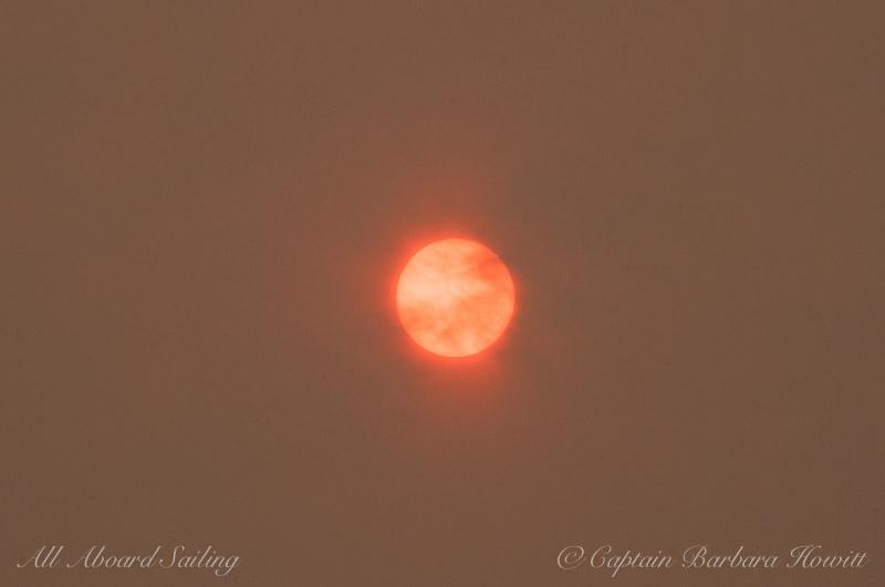 Sun shines through haze of forest fires.