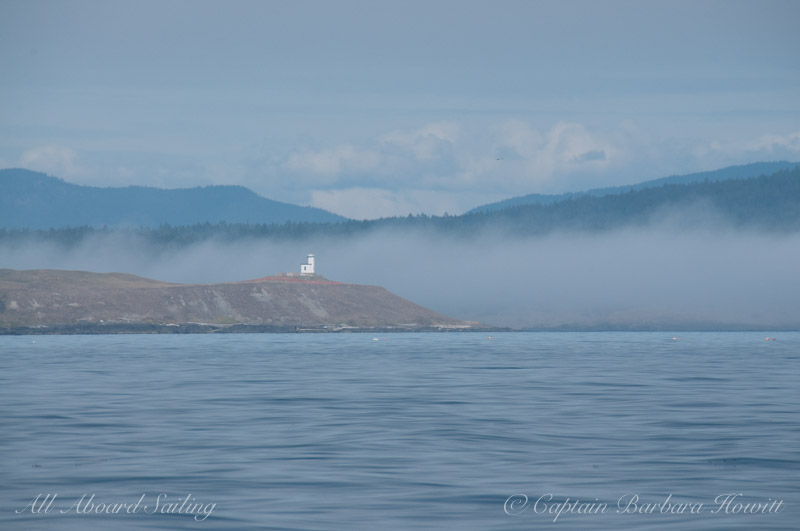 Cattle Point Lighthouse with fog in the Pass