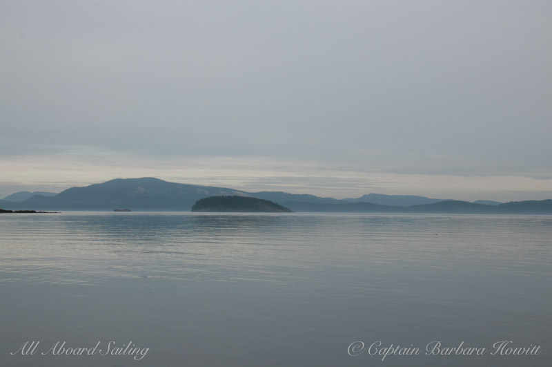 Glassy seas - a gray day but sun working to shine through